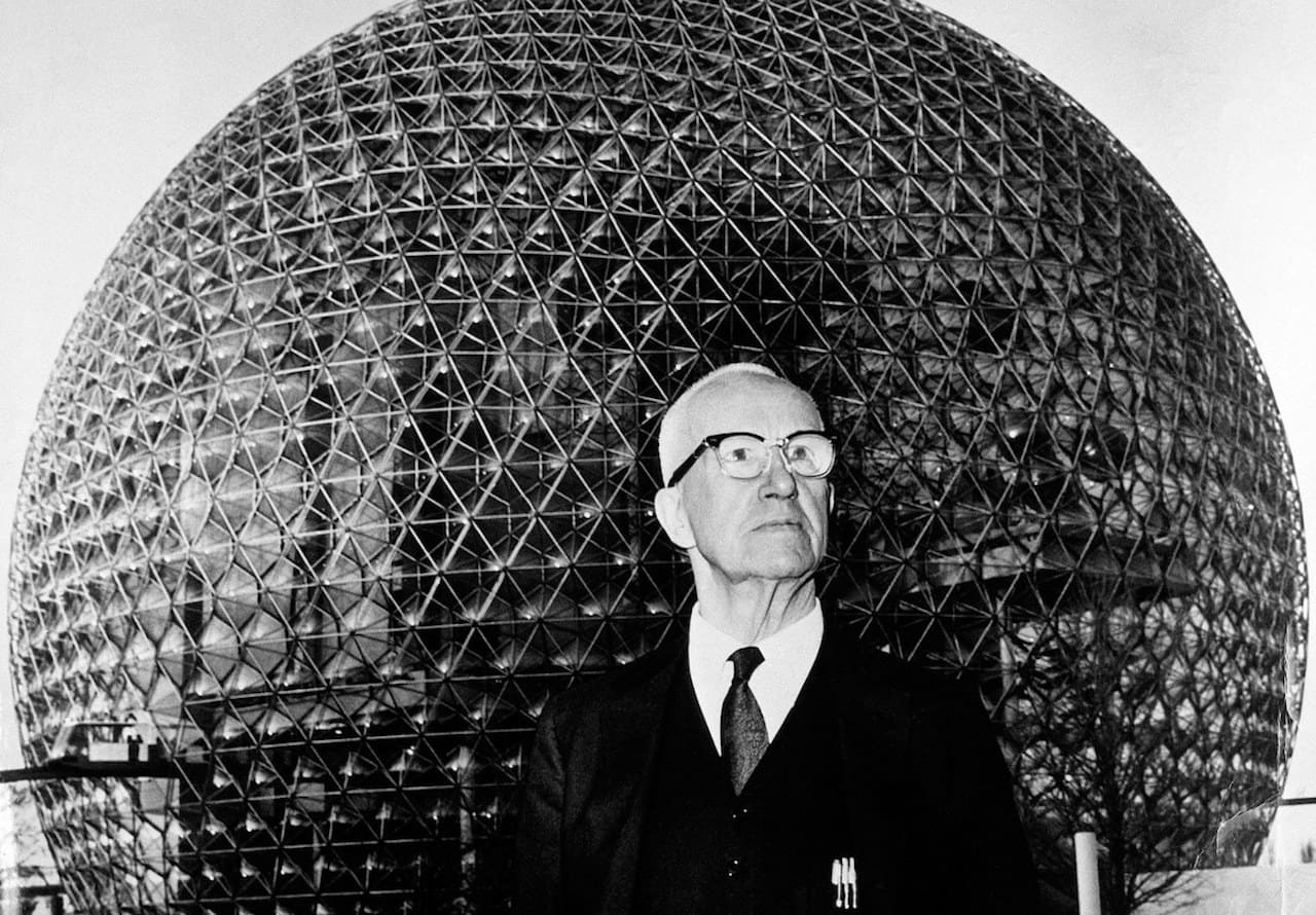 Buckminister Fuller in front of a geodesic dome
